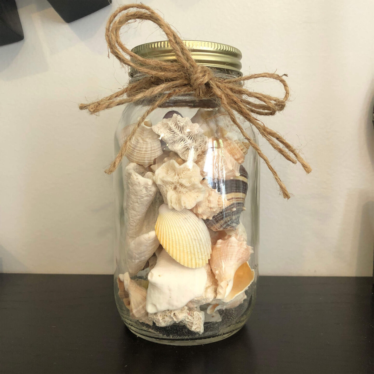 mason jar of shells with twine bow